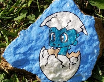 Glow in the dark baby dinosaur dragon hatching from egg painted rock