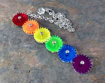Rainbow cascade - moving rainbow cogs necklace.
