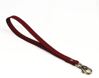 Burgundy leather with snap strap