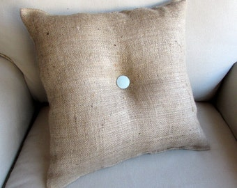 16 inch square natural burlap with center button in SPA blue