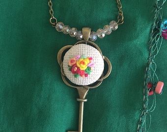 Key embroidery necklace detailed with yellow rose. Free shipping US only.