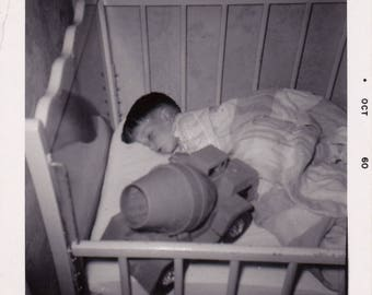 Asleep with his new truck - Found Photograph, Original Vintage Photo, Photograph, Old photo, Snapshot, Photography,