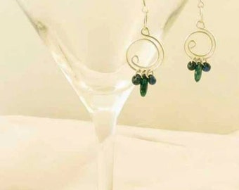Loopy silver wire earrings with green glass dagger bead dangles