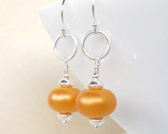 Sun kissed orange Lampwork earrings in sterling silver