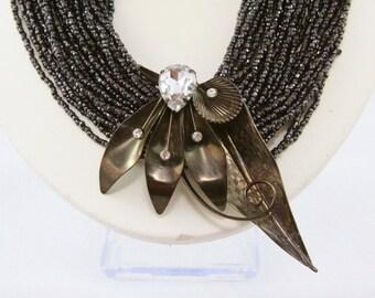 Micro Bead Necklace with Modern Brood Pendant Laguna