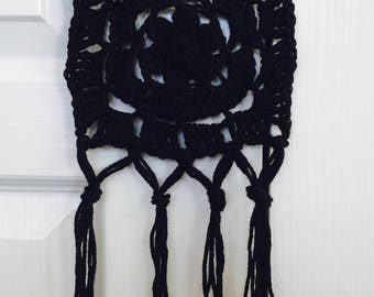 Black crochet wall hanging