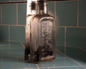"Antique ""Black Cat"" Brand Stove Polish Clear Glass Bottle"
