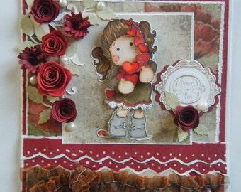 Carte sur le thème coeur, tons rouge, avec un personnage 3d