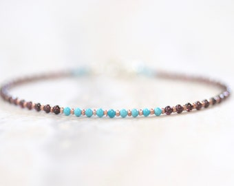 tiny turquoise and garnet beaded bracelet with rose gold seed beads. delicate string bracelet. tiny garnet and turquoise string bracelet