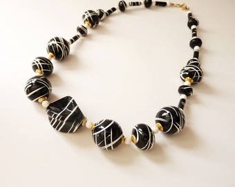 Black and White Hand Painted Artisan Bead Necklace With White and Gold Accents - 18 Inches