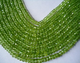 Peridot Faceted Machine Cut Roundel Beads Size 3.50 to 4 mm String Lenth Is 13'' inch Total String 1 .