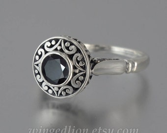 The SECRET DELIGHT silver ring with black Spinel and white sapphires