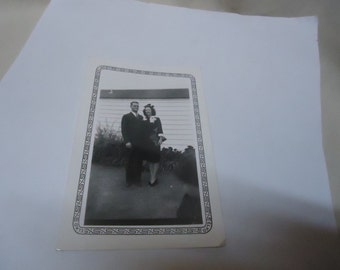 Vintage 1942 Black and White Photo Of A Man and Woman Standing Beside House, collectable