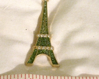 Sap Polyne Vintage Eiffel Tower Brooch - 1 diamante missing - green and gold tone - Made In France