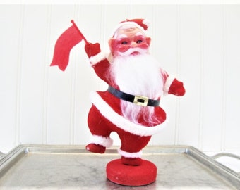 vintage santa claus dancing with flag flocked plastic