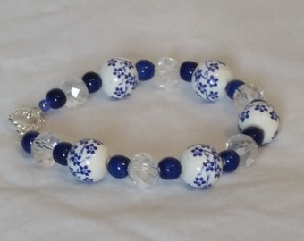 White beads with blue flowers bracelet