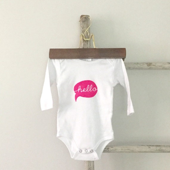 Hello. Speech bubble hello. Neon pink or white hand printed baby onesie. Screenprint baby bodysuit