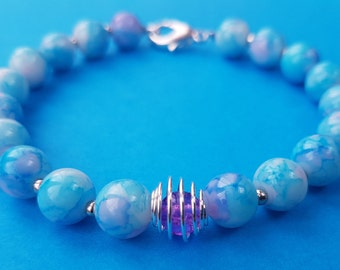 Marbled bead bracelet with spiral cage