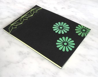 HANDMADE NOTEBOOK A6, Japanese stab-bound, lime cotton thread, 40 blank green and yellow pages, black cover, green stencilled daisy pattern