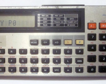 Vintage Casio FX-700P Programmable Calculator