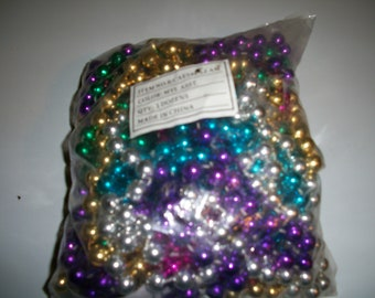 One dozen assorted Multicolored Mardi Gras Beads Sealed