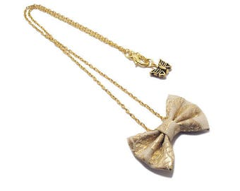 Bowtie necklace, fabric, chain, gold.