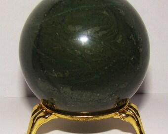 Natural green tinguaite sphere. Siberian Region, Russia. Uncommon mineral