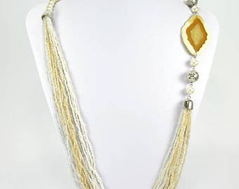 Free shipping. Ivory and sand MULTISTRAND beaded necklace