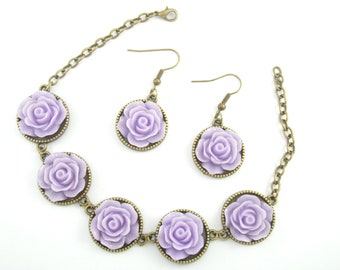 Set bracelet and earrings supports bronze metal studs and lavender resin flower cabochons