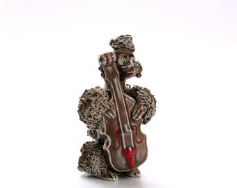 vintage spaghetti poodle figurine with violin or double bass, made by Thames, hand painted Japan