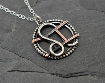 Gemini Leo necklace sterling silver and copper with beaded edging oxidised