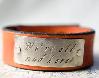 We're All Mad Here-  Alice in Wonderland -  Adjustable Leather Snap Cuff with Engraved Metal Plate
