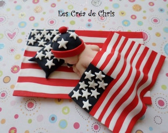 mixed polymer clay baby sleeping on his American flag.