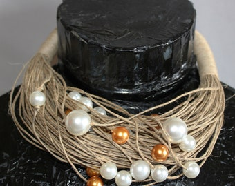 String necklace with golden and white beads