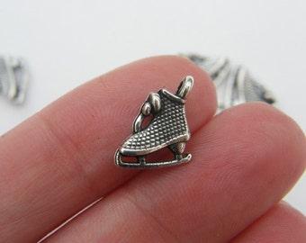 10 Ice skate charms tibetan silver SP50