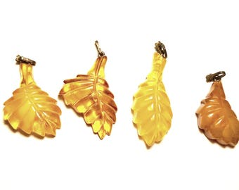Amber group of 4 carved leaves
