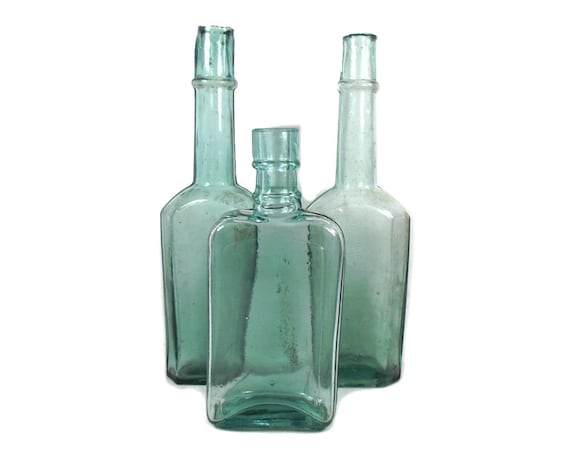Antique Set of Aqua Glass Bottles