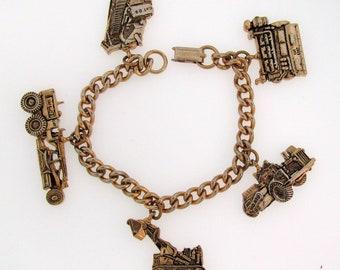 "Vintage CATERPILLAR Tractor Co Gold-tone Bracelet CONSTRUCTION Equip CHARMS 7.5"""