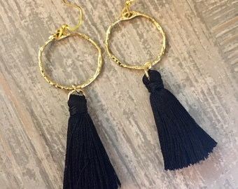 Black silky tassle earrings with gold hammered rings. Black tassel earrings