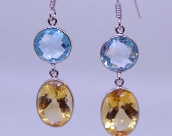 Beautiful yellow topaz and blue topaz earrings set in sterling silver.