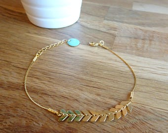 Serpentine gold chain and gold spike chain bracelet