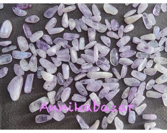 Set of 30 to 35 natural Amethyst beads of various shapes and sizes