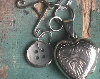 Silver heart locket with button and initial