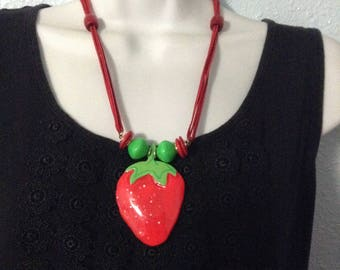 Vintage acrylic and cord strawberry necklace, red and green, spring insert closure, fun jewelry.