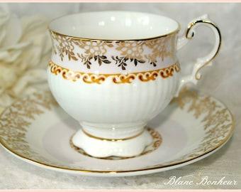 Elizabethan Staffordshire, England: Pedestal pink and gold tea cup & saucer