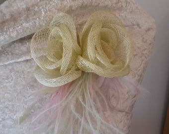 Jewelry brooch of ceremony. Sisal, feathers and tulle flowers.