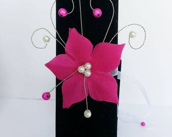silver wedding bracelet and fuschia pink silk satin flower