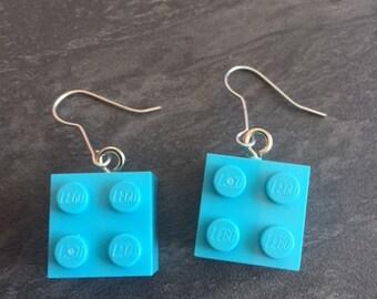 pair of light blue lego earrings