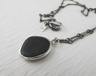 silver bezel set black beach stone & gunmetal chain necklace