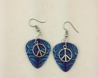 Polymer clay blue and purple guitar shaped earrings with peace sign charms